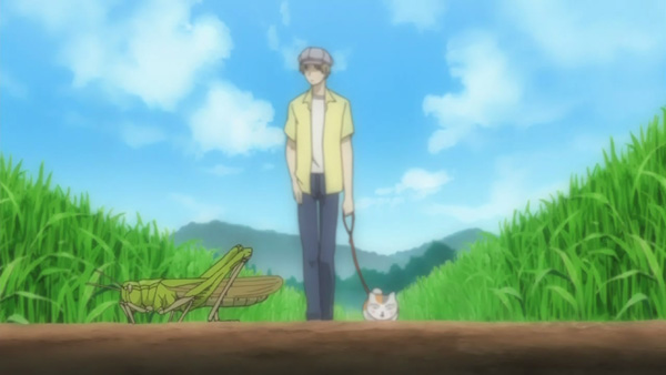 Natsume walking his cat