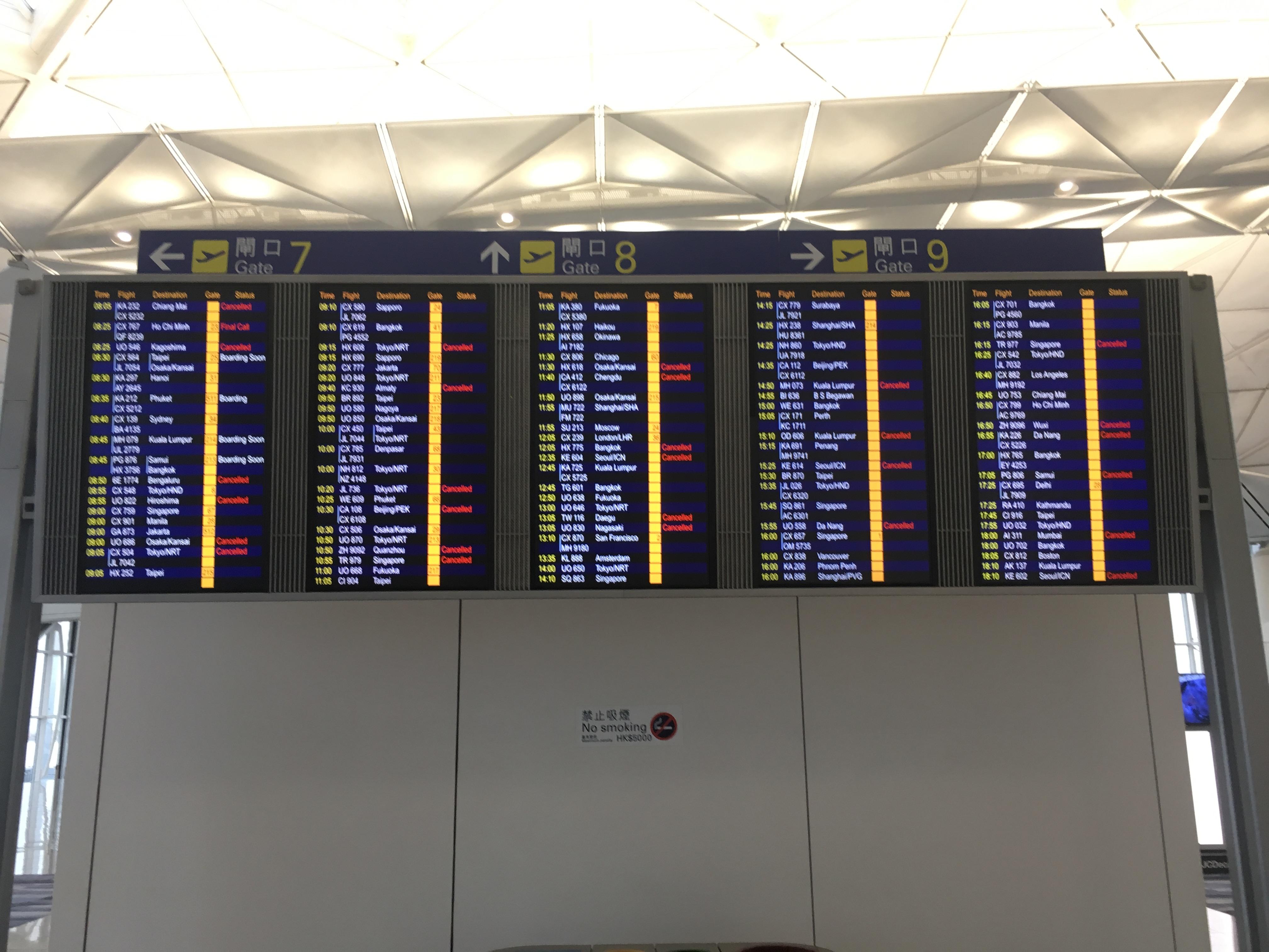 The flight departures board at Hong Kong airport, March 2020
